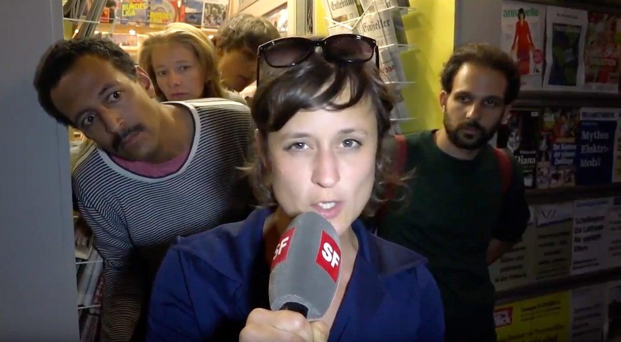«Schweiz aktuell»-Reporterin führt durch den vermeintlichen Image-Film, die Flüchtlinge interessiert's.