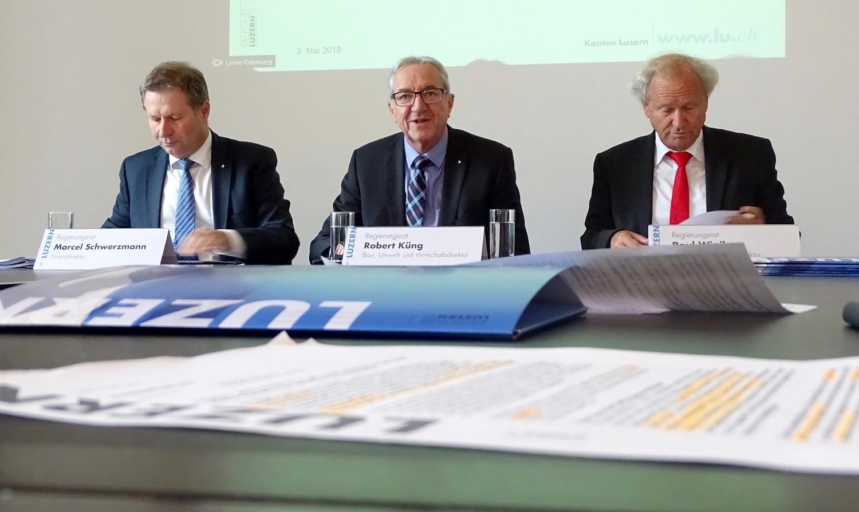 Marcel Schwerzmann, Robert Küng und Paul Winiker bei der Präsentation des Reformpakets diesen Frühling.